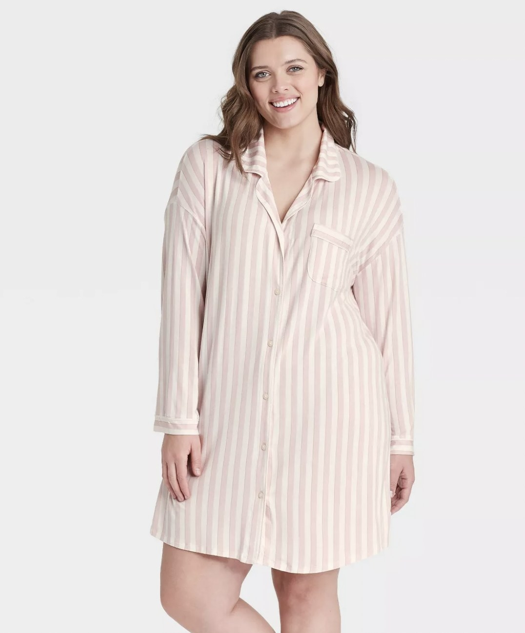 A model wearing a striped, long sleeved nightgown