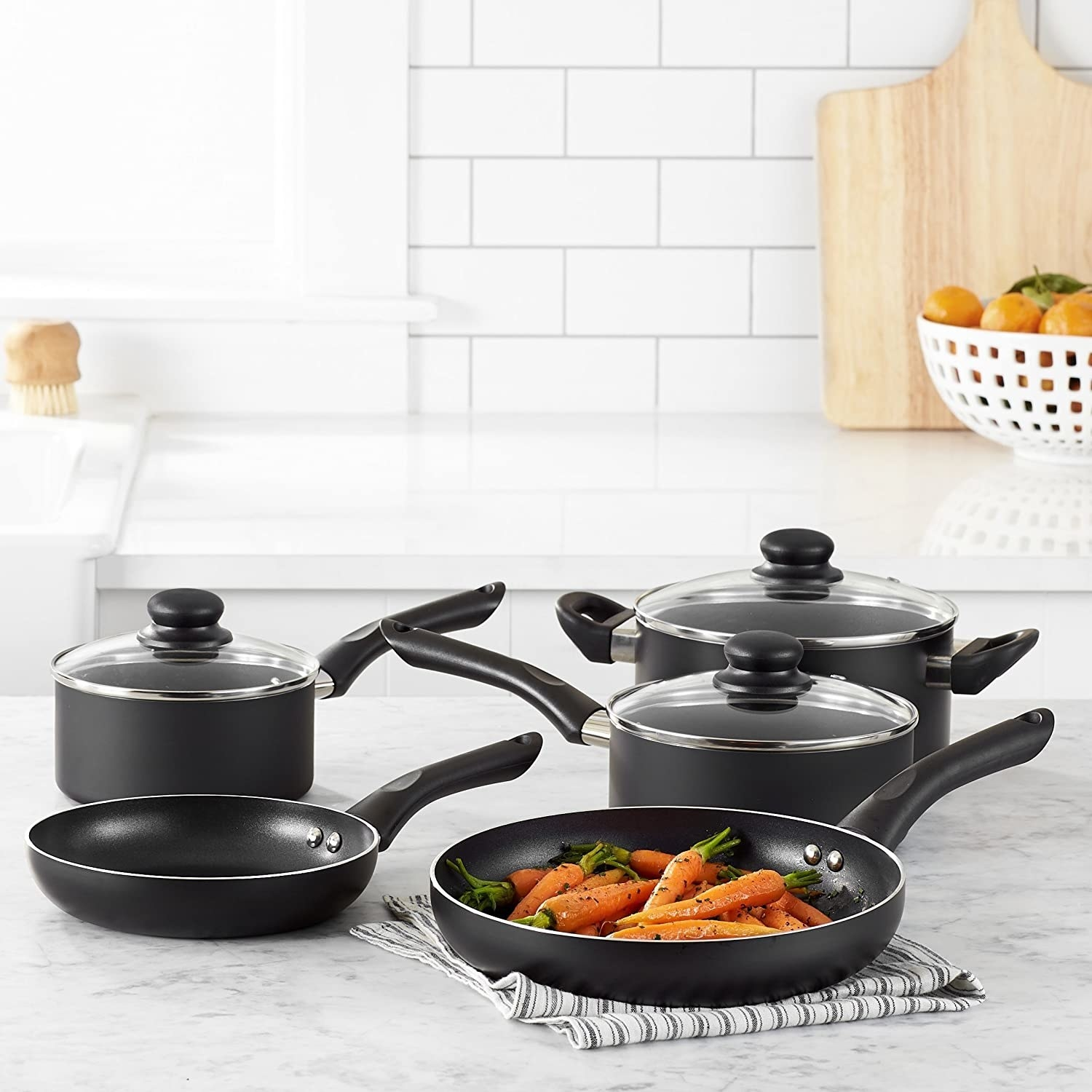 A non-stick cookware set with carrots inside