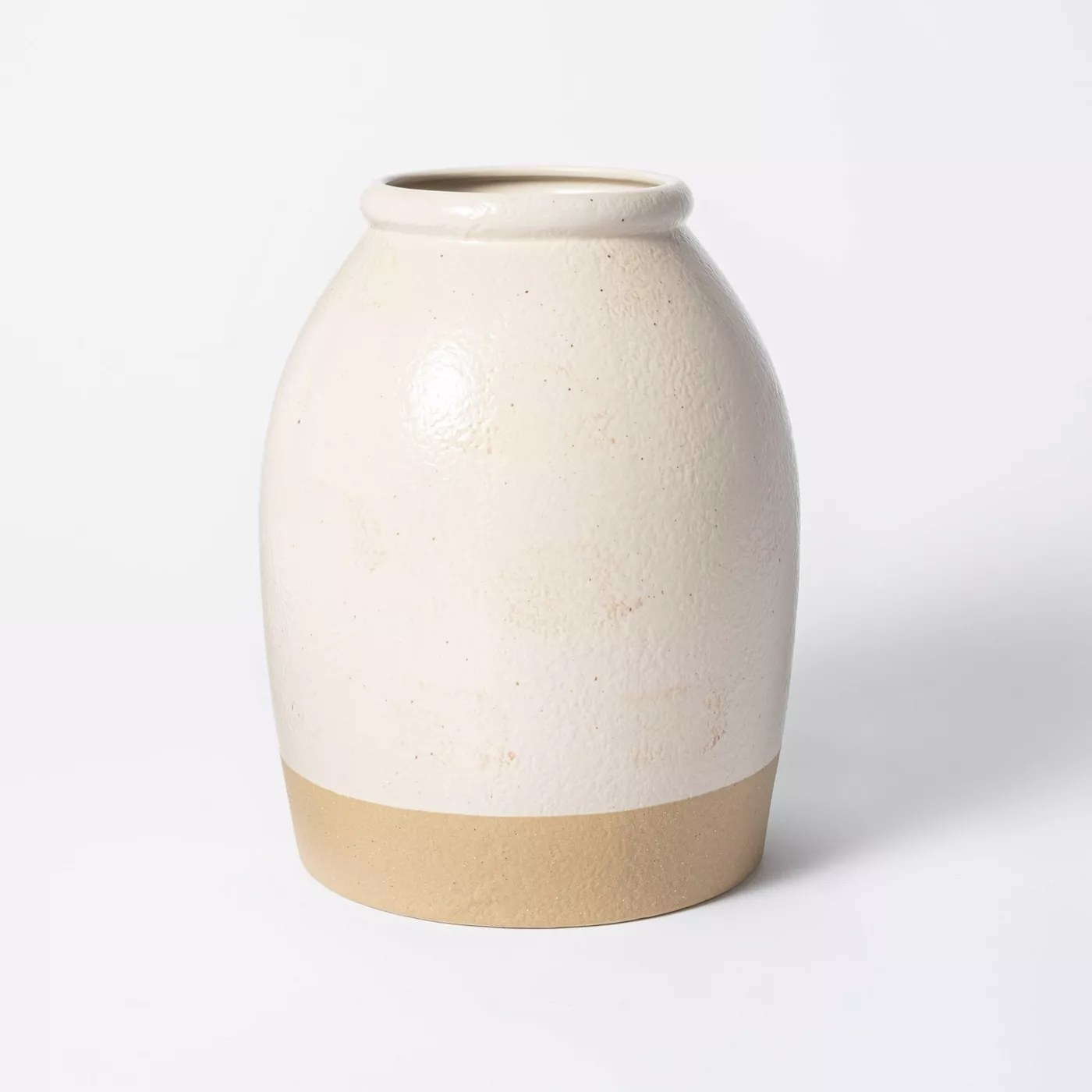A close-up of the vase against a gray background