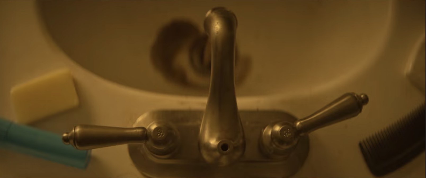 Brownish water spewing from a bathroom faucet