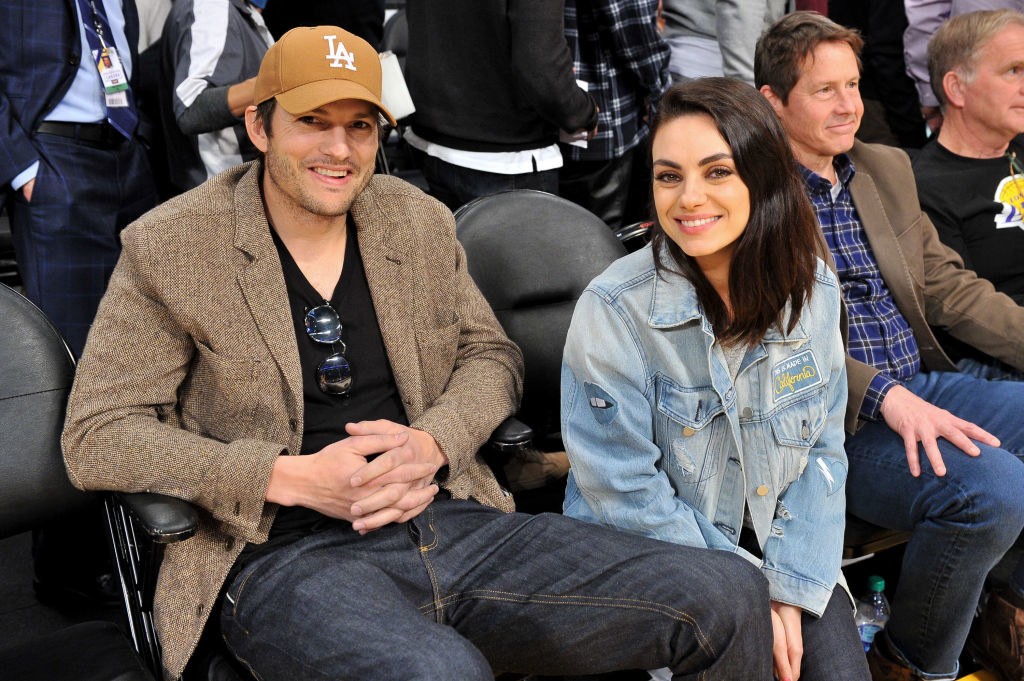 Ashton Kutcher and Mila Kunis at a basketball game between the Los Angeles Lakers and the Philadelphia 76ers