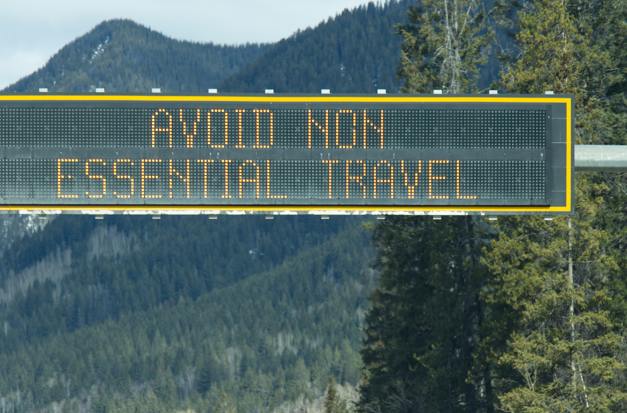 "sign on Trans-Canada Highway ""Avoid non-essential travel"""