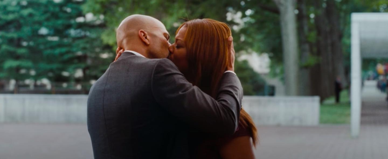 Scott and Leslie kissing