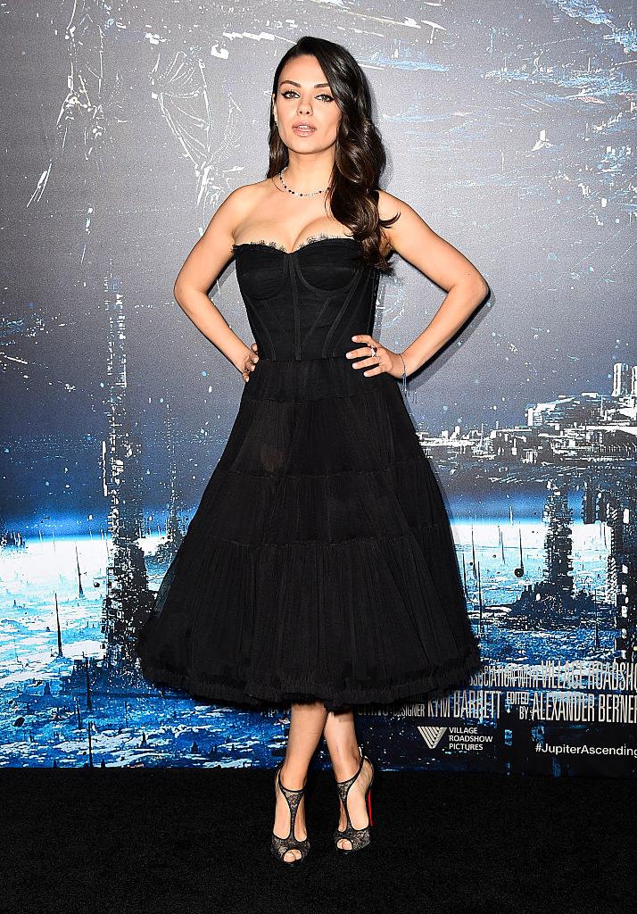 "Mila Kunis wearing a tea-length strapless dress at the premiere of Warner Bros. Pictures' ""Jupiter Ascending"""
