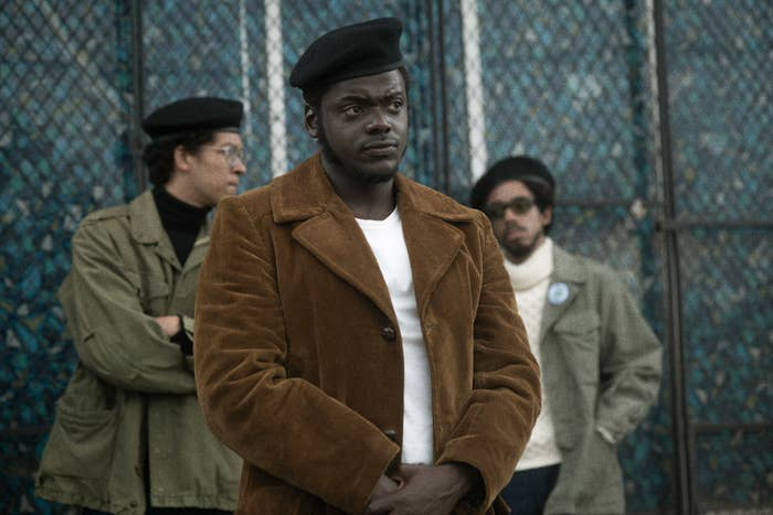 Daniel Kaluuya as Fred Hampton wearing a t-shirt, coat, and a black beret