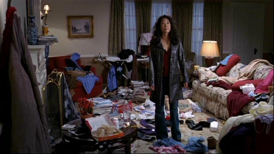 """Actress Sandra Oh showing her messy bedroom to Burke in a scene from """"Grey's Anatomy."""""""