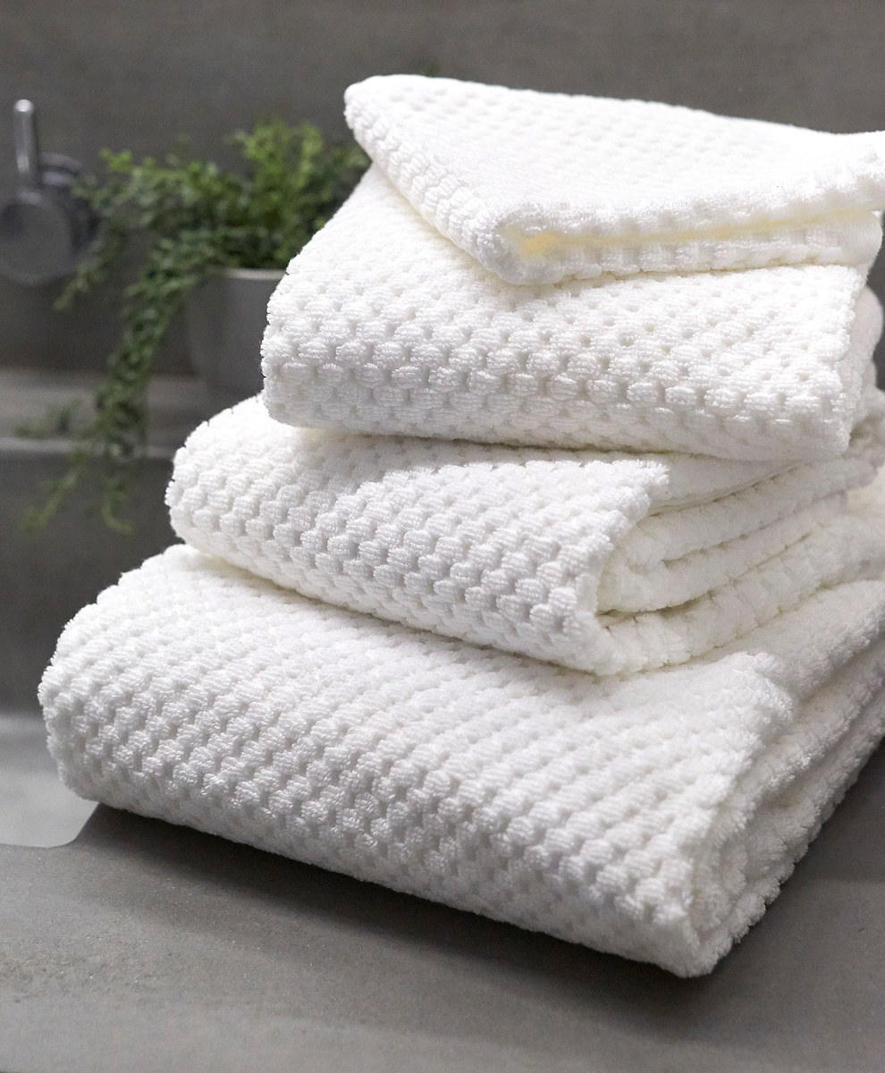 stack of white waffle towels
