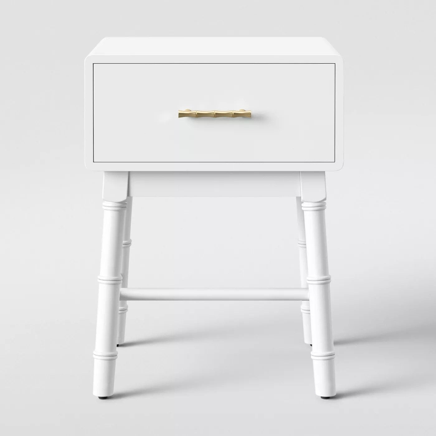 The blue nightstand with a gold handle