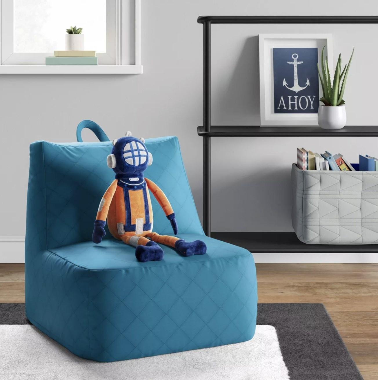 A pale blue lounge chair
