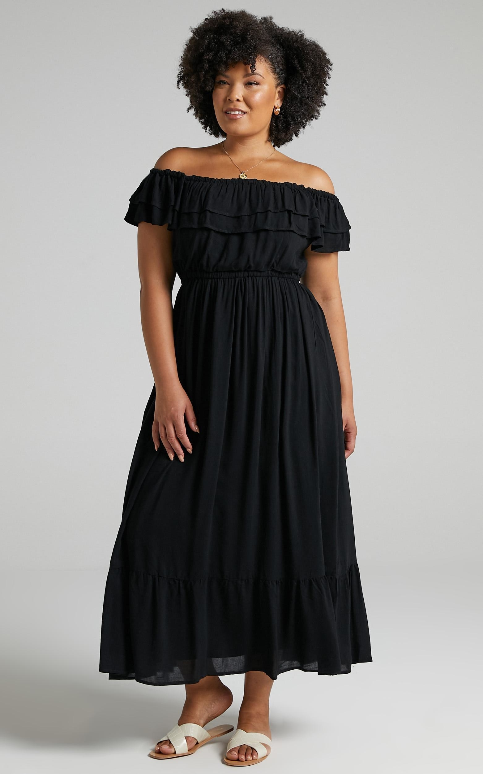 model wearing black maxi off shoulder dress