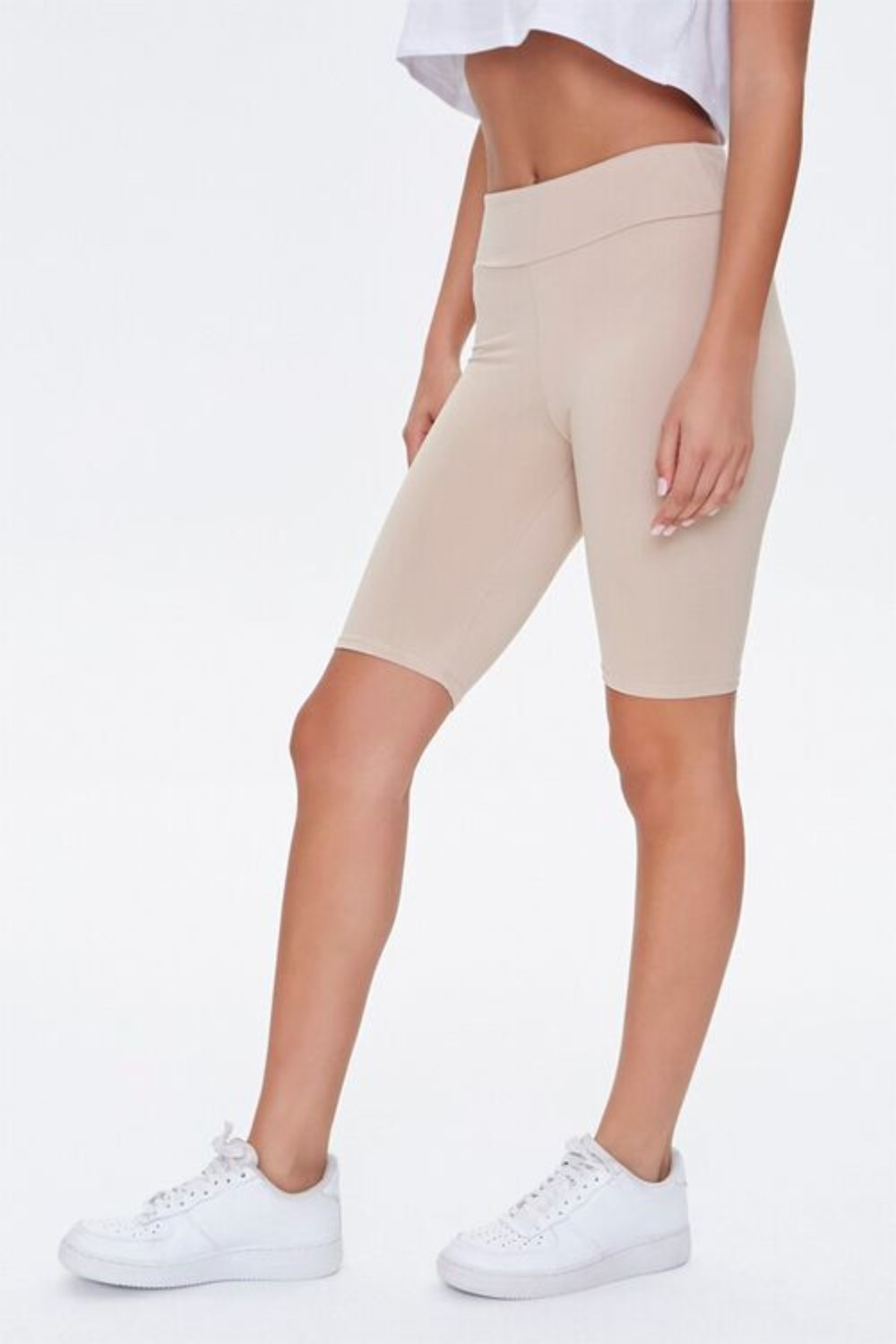 Model wearing the shorts in taupe from the legs down