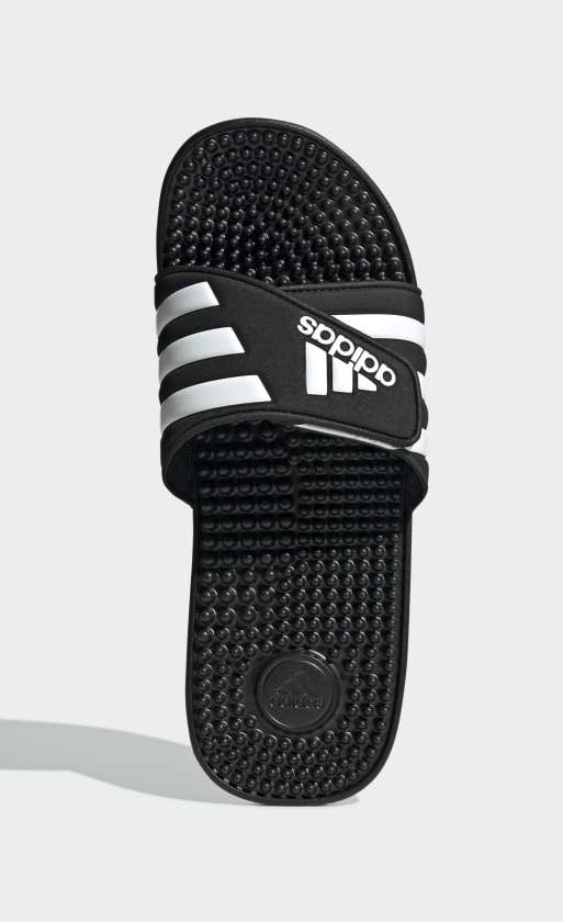 black adidas slide shoes with nubs on the bottom to massage your feet