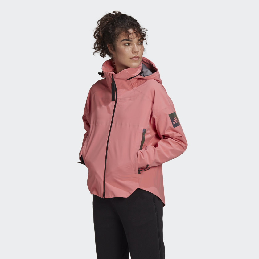 salmon colored rain jacket with lots of pockets