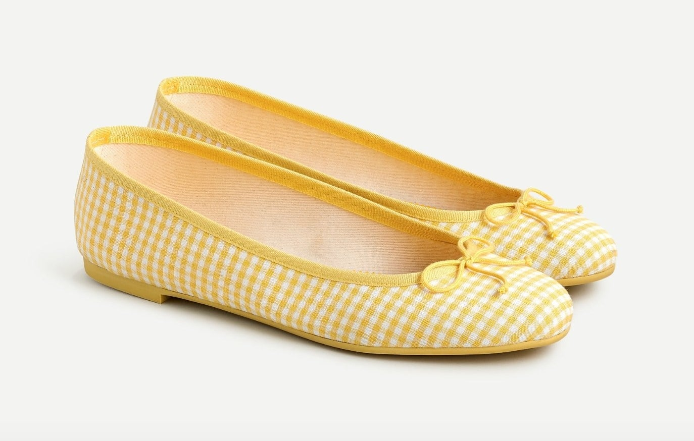 The ballet flats in yellow/ivory