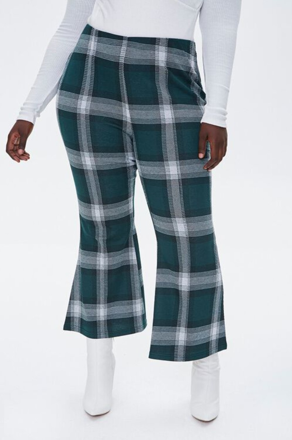 Model wearing the pants in hunter green from the waist down