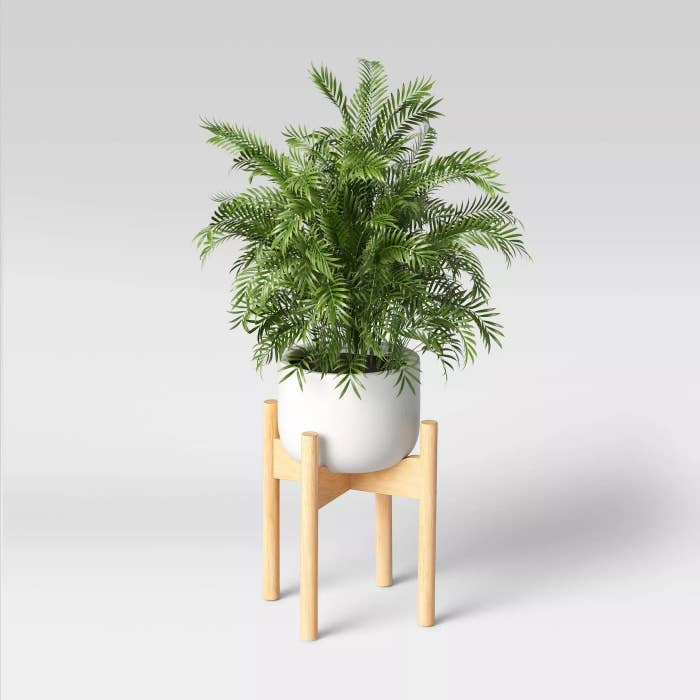 The planter with a potted plant