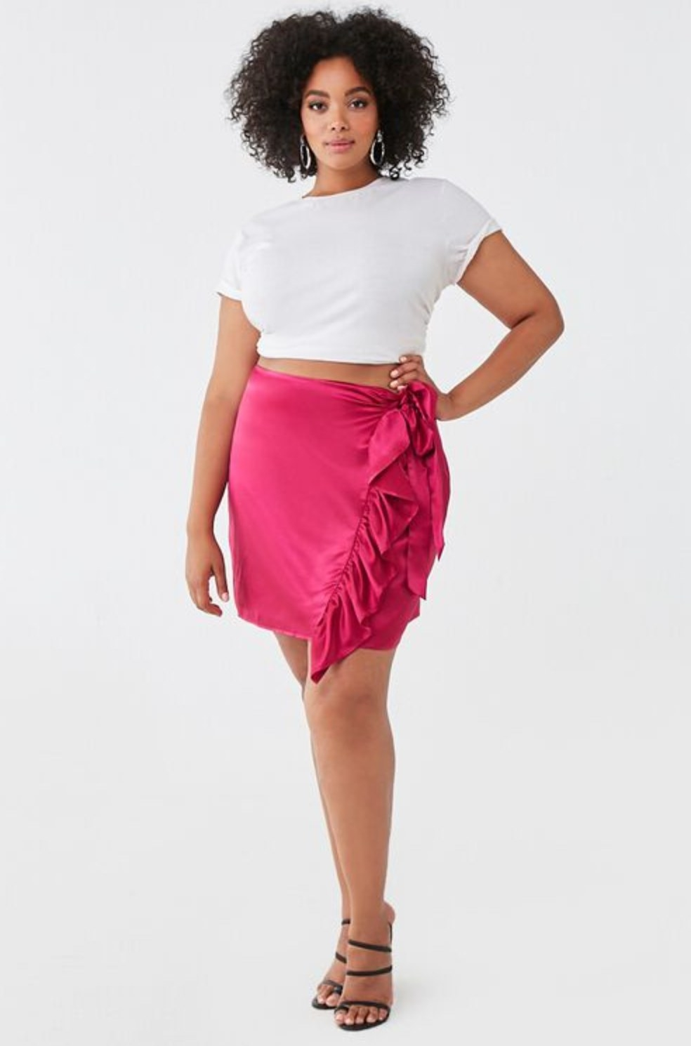Model wearing the skirt in magenta