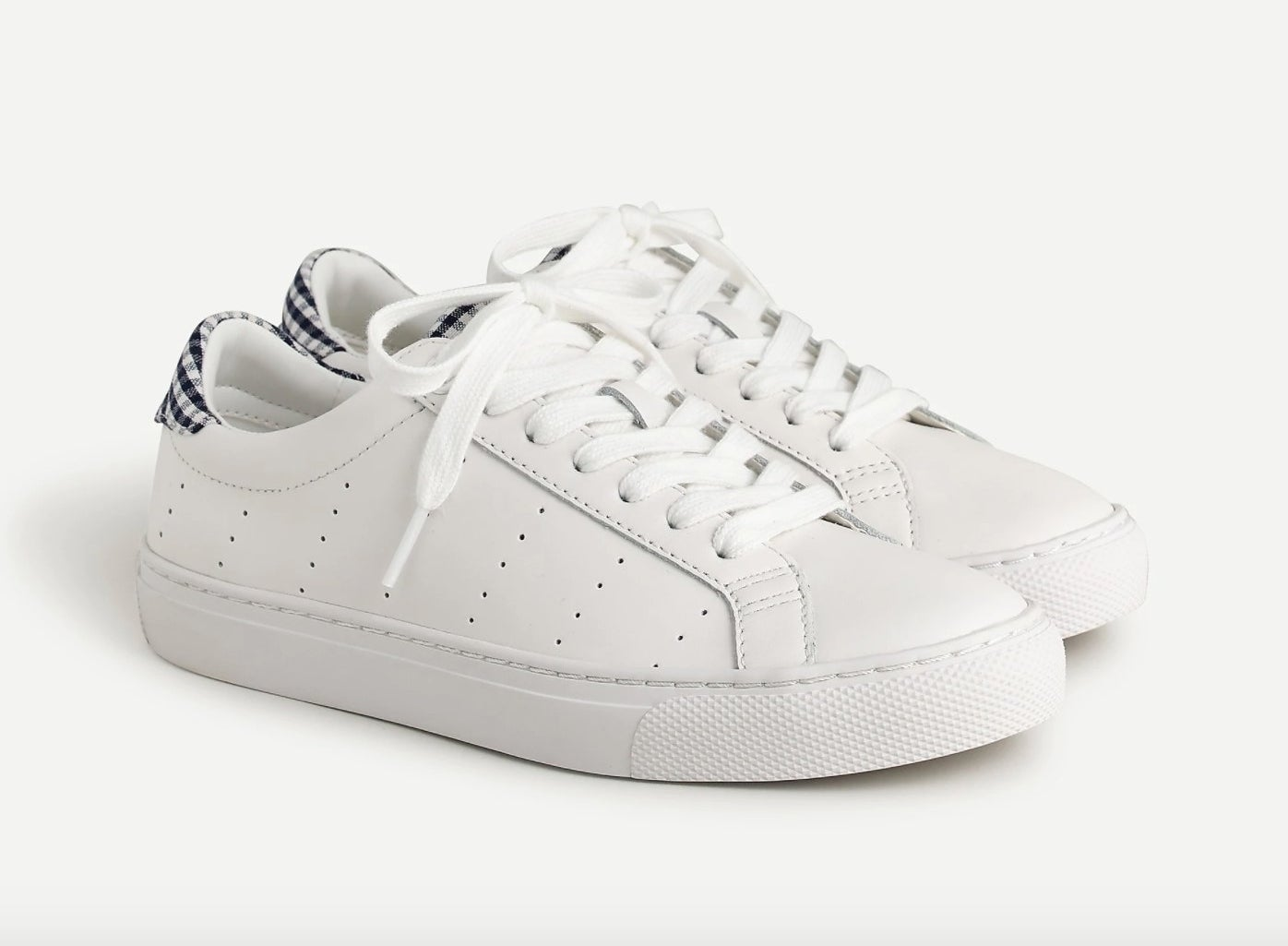 The sneakers in white with gingham on the heels