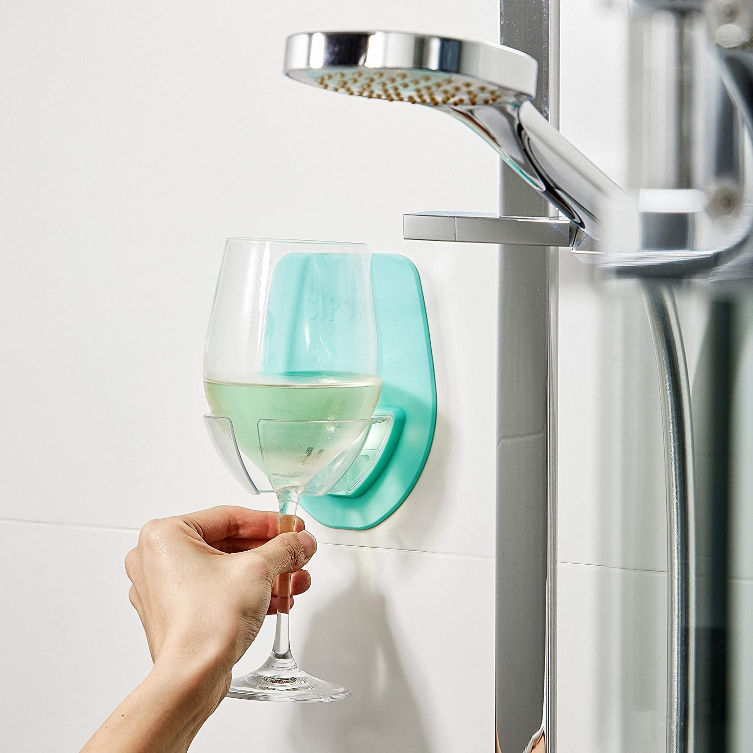 a model using the silicone holder to put their wine glass in the shower