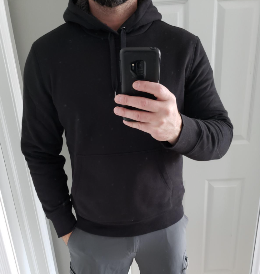 A reviewer wearing the hoodie
