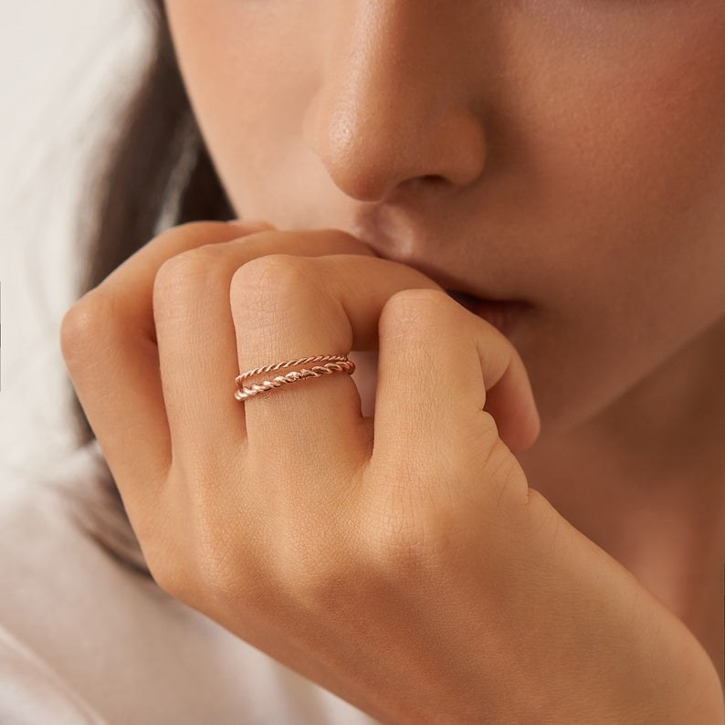 Model wearing the ring in rose gold
