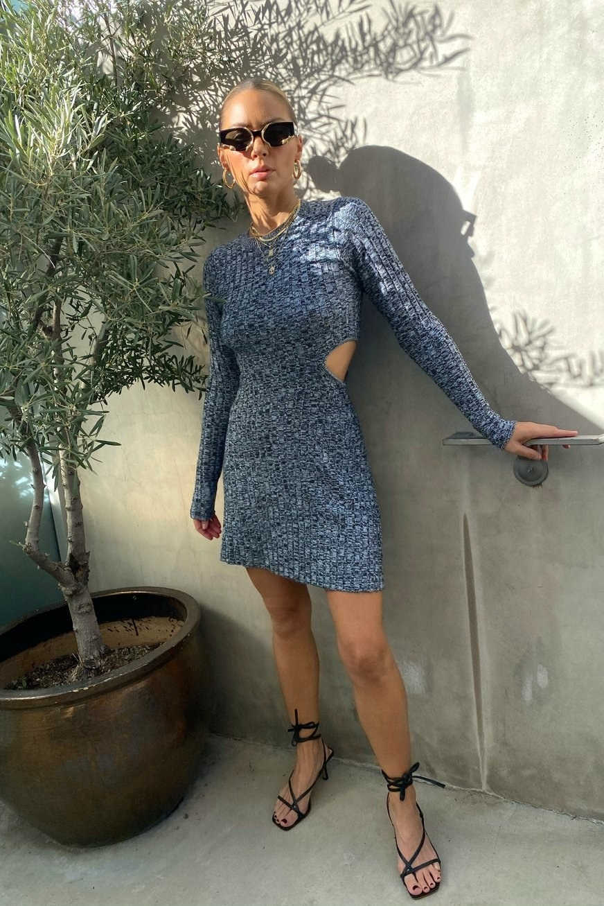 model wearing the blue marled mini dress with cutouts
