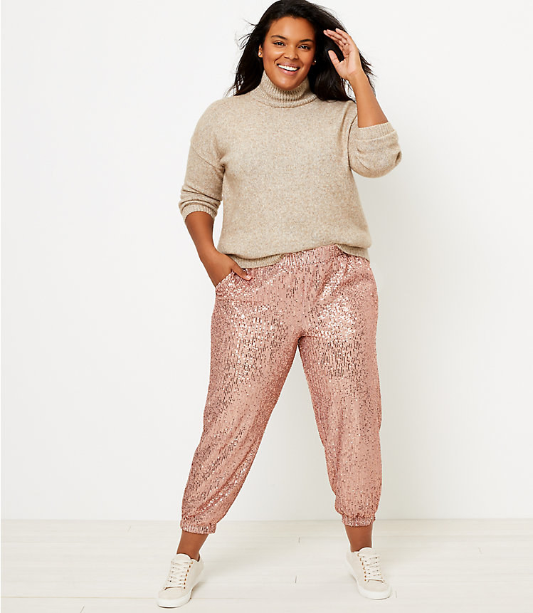 model wearing rose gold sequin pants with a hand in the pocket