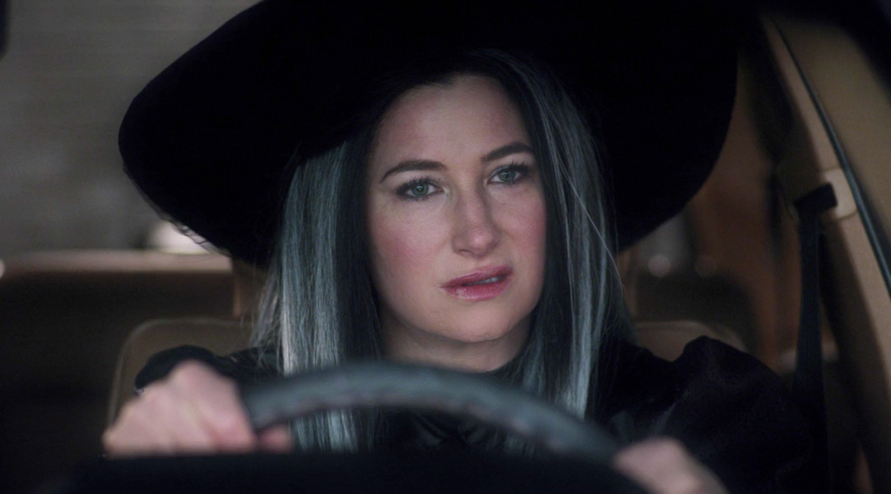 Agnes dressed as a witch as she sits behind the wheel of a car