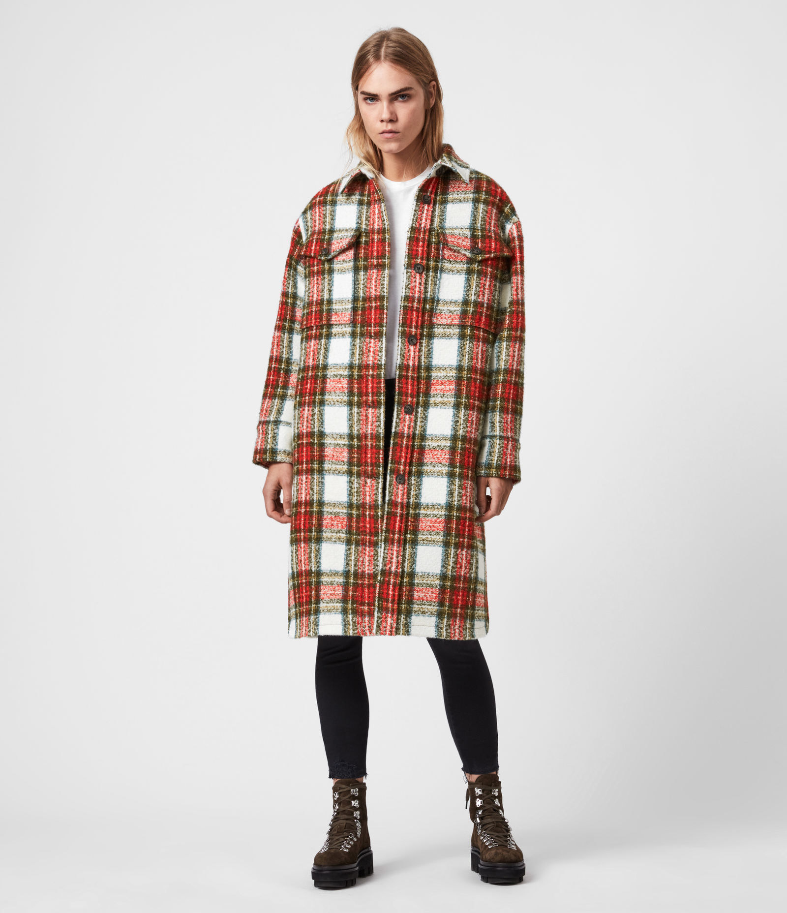 model wearing red and white checkered coat