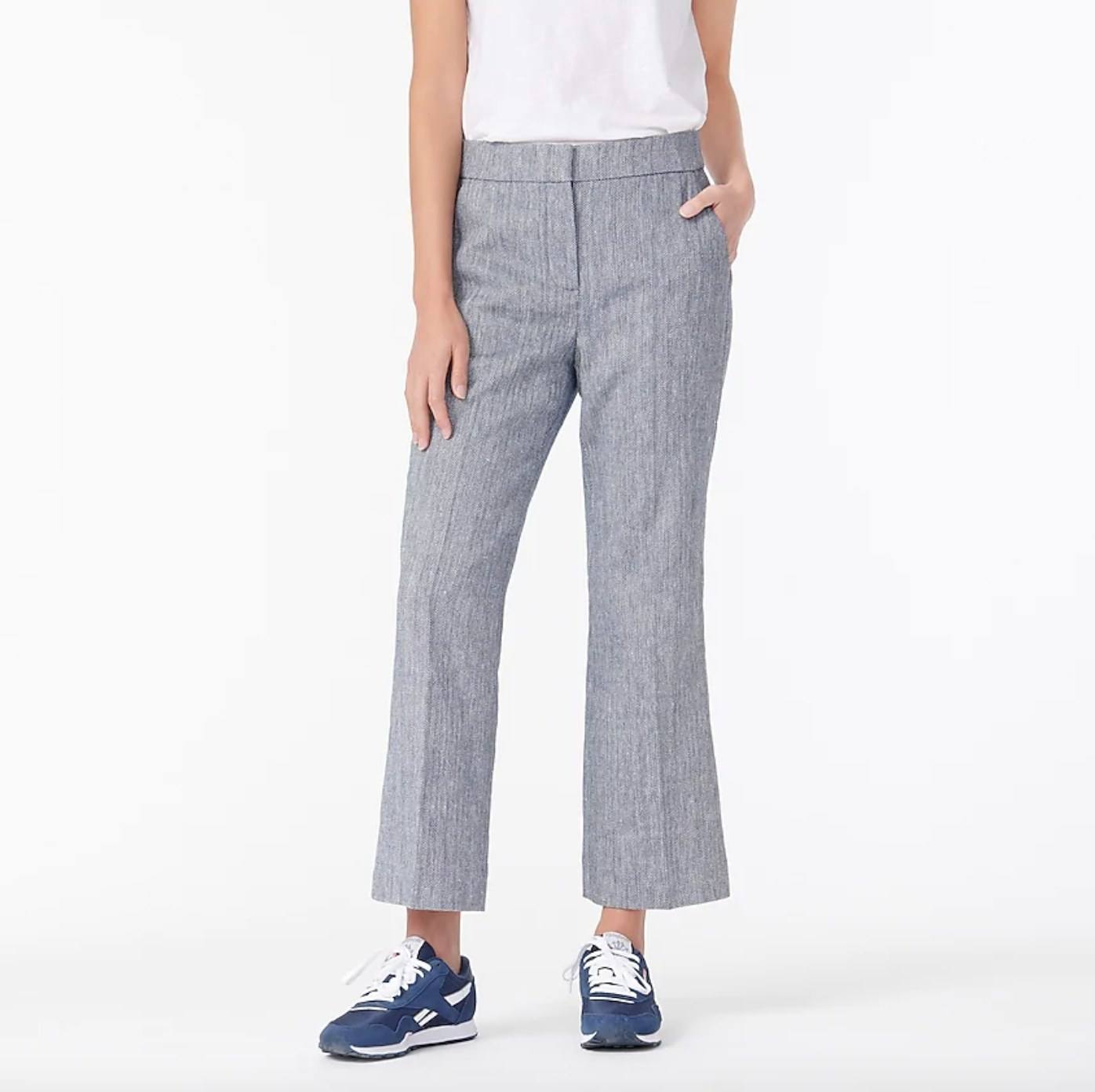 Model wearing the pair of cotton-linen trousers