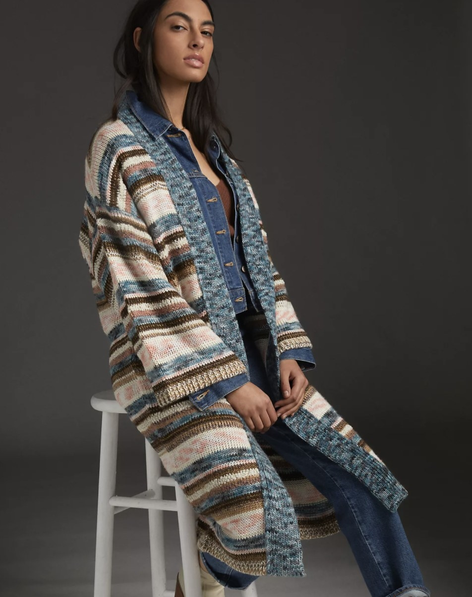 Model is wearing a duster kimono, denim jacket, and denim pants