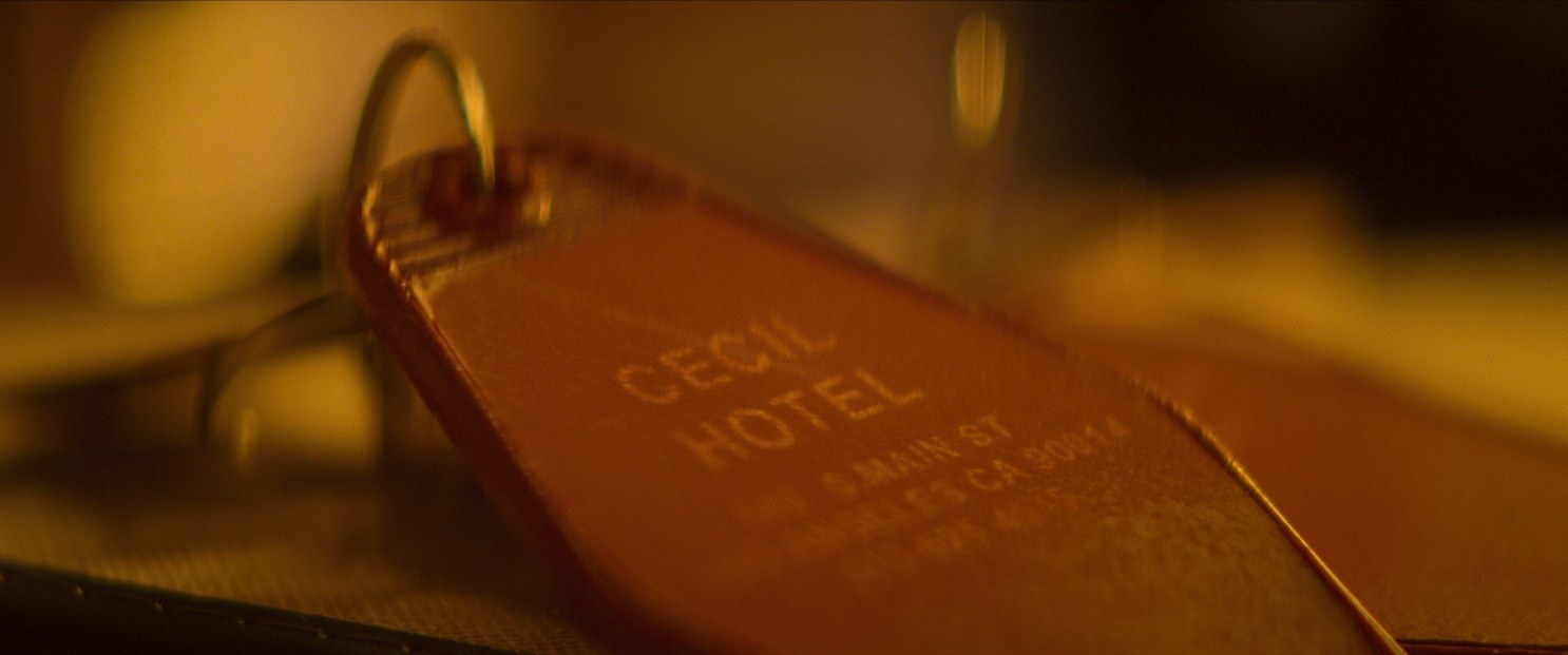A close-up of a hotel key to the Cecil