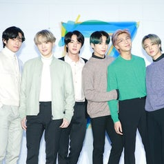 BTS poses together at the press conference for map of the soul 7