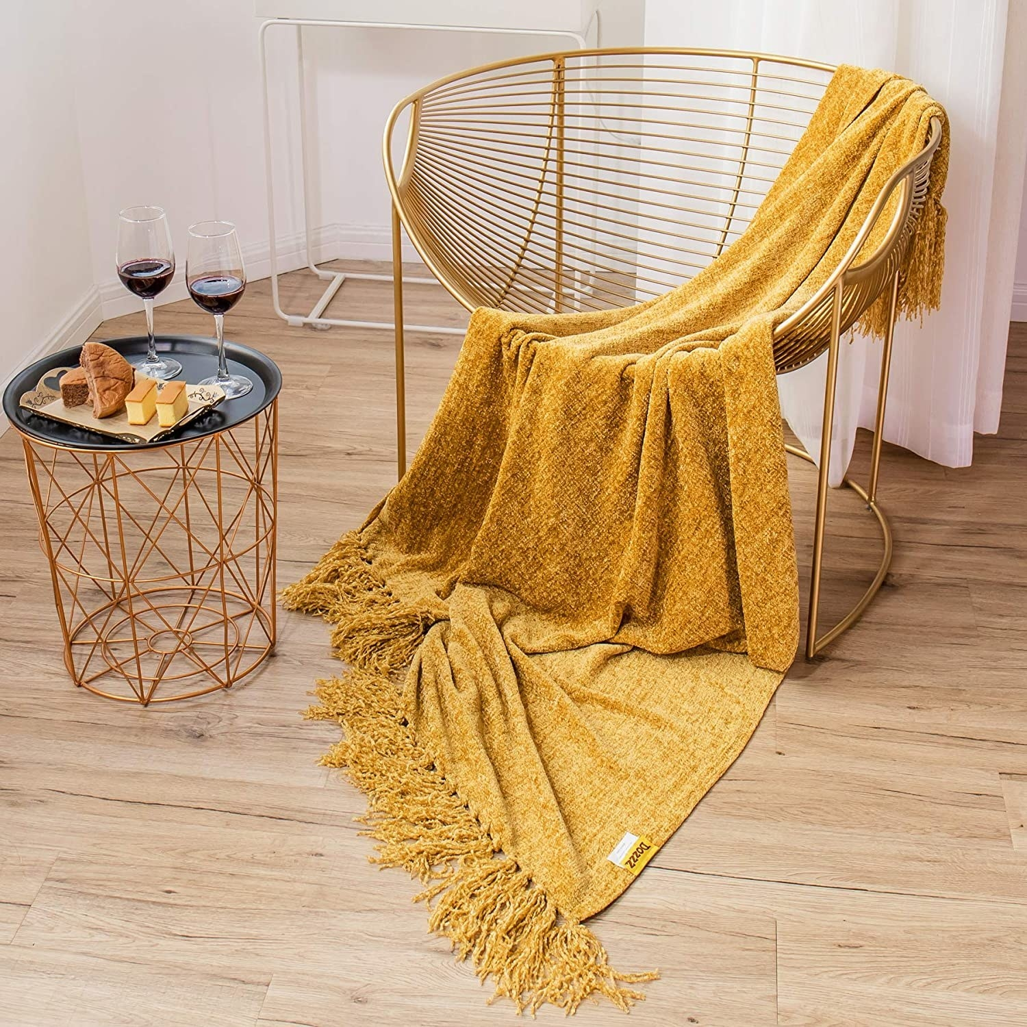 modern chair with a golden yellow chenille throw blanket on it