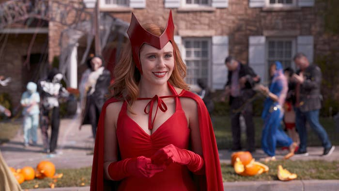 Wanda Maximoff dressed in a red, caped Halloween costume with a helmet that looks like one from the old comics