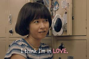 "Maya in Pen15 by her locker saying ""I think I'm in love"""