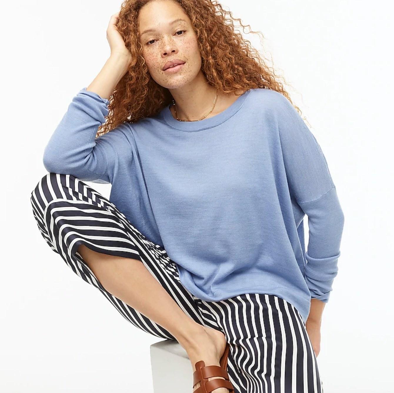 model wearing light blue sweater