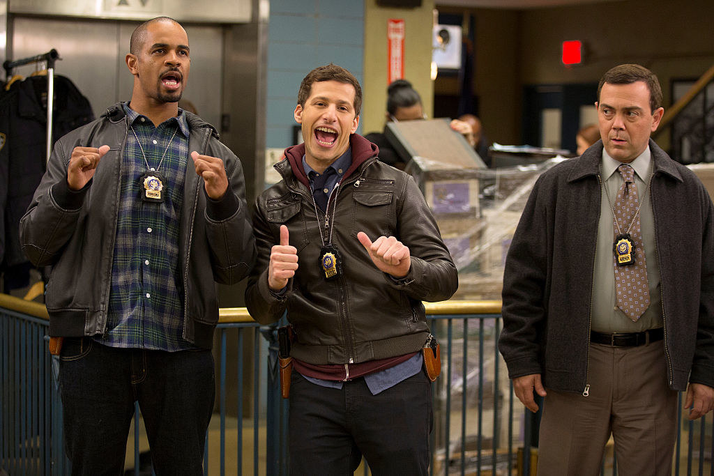 Guest star Damon Wayans, Jr., Andy Samberg and Joe Lo Truglio in the police station