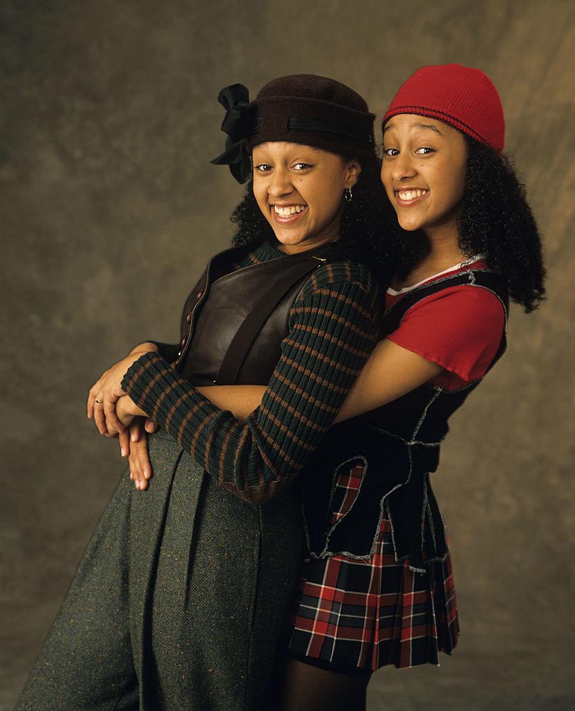Tamera Mowry and Tia Mowry embracing in promo photo
