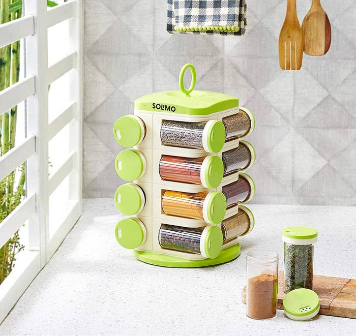 A revolving spice rack with spices in it