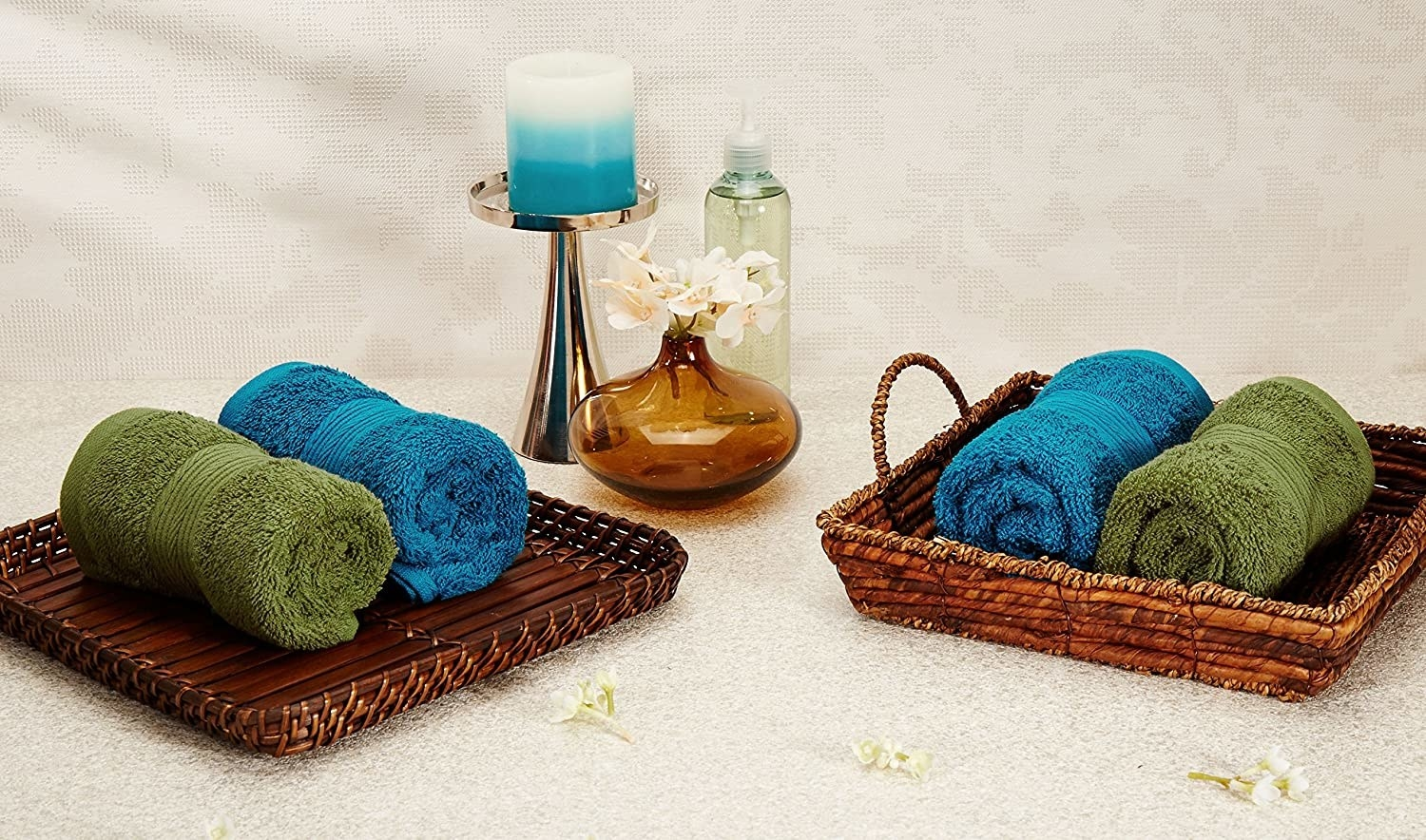 A set of blue and green towels on a rack