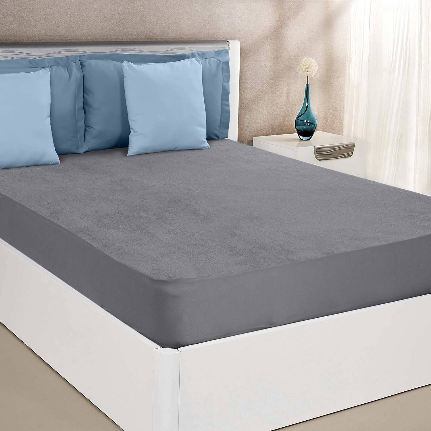 A waterproof mattress protector on a bed