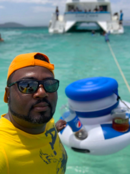 reviewer pictured with the cooler tied to a boat