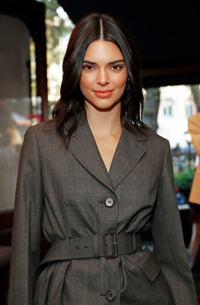 Kendall wearing a belted jacket