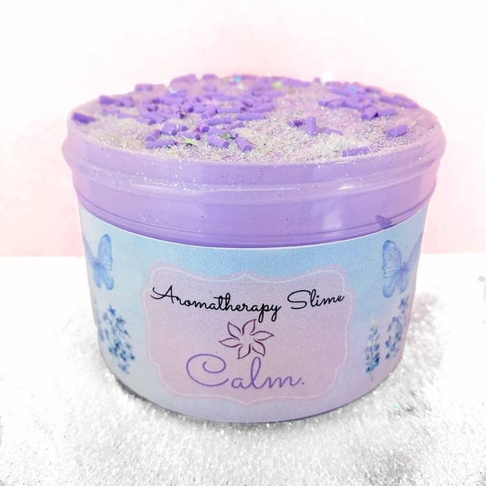 the lavender slime with shimmers and crunchy bits on the top and butterflies and flowers on the packaging
