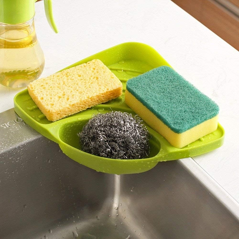 A kitchen sink organiser with sponges in it