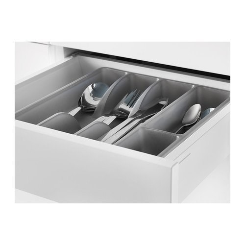 An Ikea cutlery organiser with forks and spoons in it