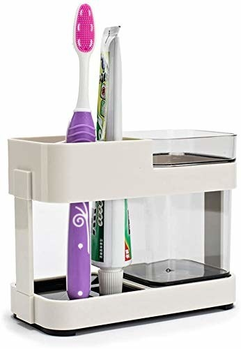 Toothpaste organiser with a toothpaste and a toothbrush in it