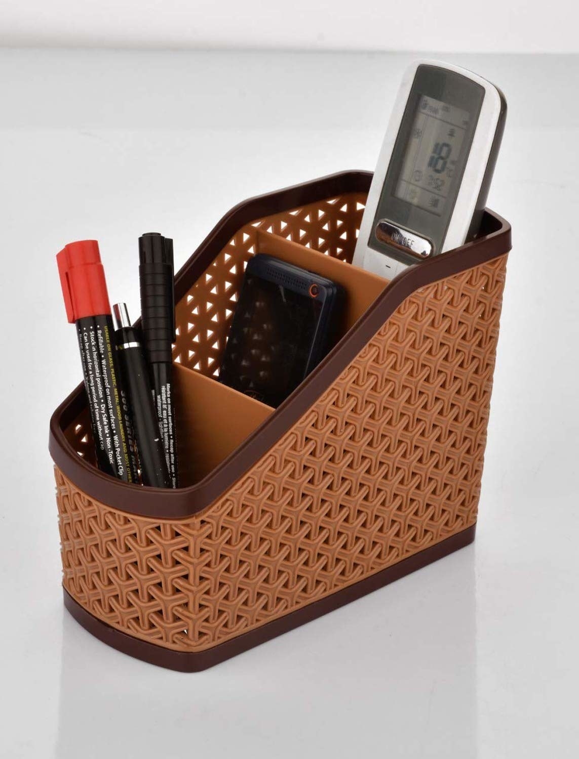 A brown organiser with items in it