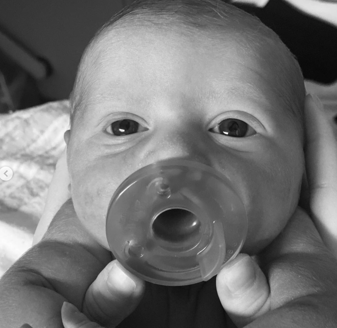 Baby Riley with a pacifier in his mouth